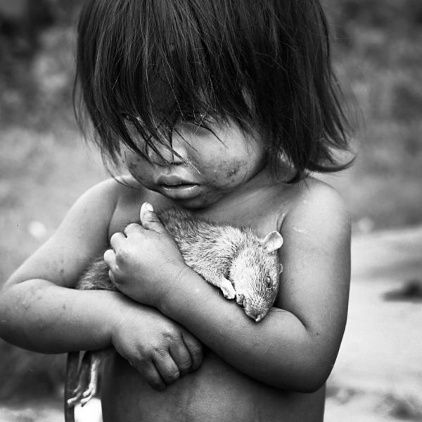 Girl with a dead rat.